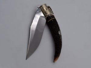 Ref-030-Large point blade folding knife with plaited brass cord.